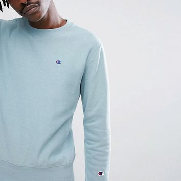 Champion Sweatshirt With Small Logo In Blue at asos.com