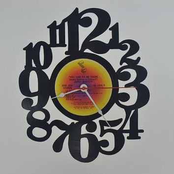 Vinyl Record Clock Hanging wall clock  (artist is Jimmy Buffett)