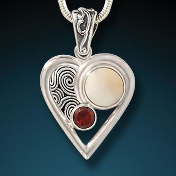 """Heartbeat"" Fossilized Mammoth Ivory Garnet and Sterling Silver Pendant"