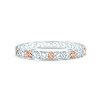 Tiffany & Co. - Tiffany Enchant® scroll bangle in platinum and rose gold with diamonds, narrow.