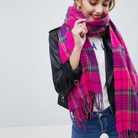 ASOS DESIGN check scarf with tassels in hot pink at asos.com