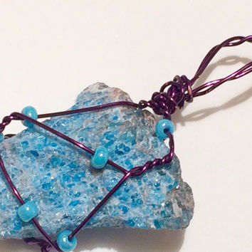 Blue Apatite wire wrapped pendant. Blue Apatite pendant with purple wire and glass beads.
