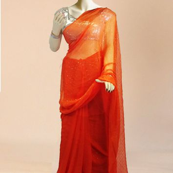 the chiffon saree in deep orange with a touch of silver sequins