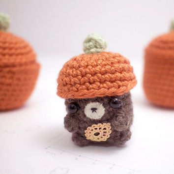 brown bear plush with a crochet pumpkin hat