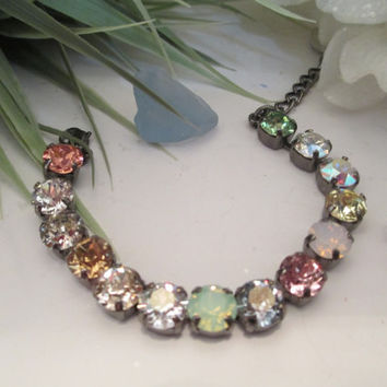 swarovski crystal 8mm bracelet in hematite setting with multicolored pastel stones. #168