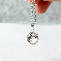Music necklace.  Vintage sheet music treble clef key signature under glass.  Dainty necklace for her