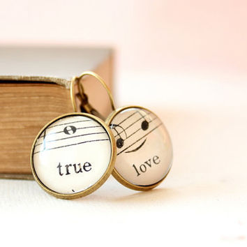 Music earrings made with upcycled vintage sheet music under glass.  Word earrings true and love