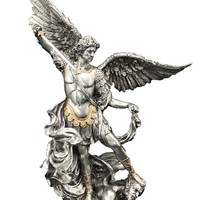A Veronese St. Michael statue in a pewter style finish with golden highlights, 10inches.