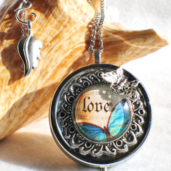Music box locket,  round locket with music box inside, in silver with Love and Butterfly  Cabochon