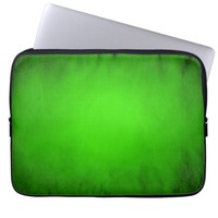 Green glowing spotlight laptop sleeve