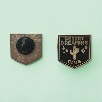 Desert Dreaming Club Lapel Pin in Black and Gold