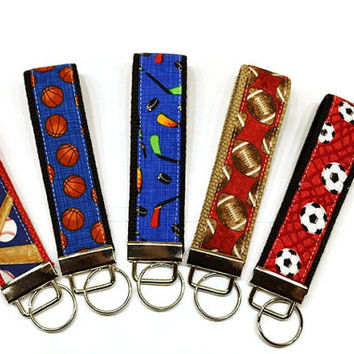 Sports theme key fobs wrist keychain: baseball, basketball, hockey, football and soccer! ADD A NAME option. Backpack name tag.