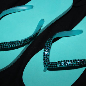 Beautiful teal flip flops covered in teal Swarovski Crystals that add tons of bling and sparkle