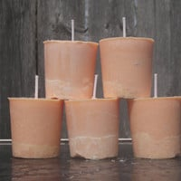Honeysuckle and Gardenia scented candles, peachy colored vegan votive
