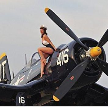 Christian Kieffer Poster Print entitled 1940's style Navy pin-up girl sitting on a vintage Corsair fighter plane