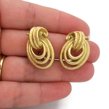 Monet Textured Gold Clip Earrings - Abstract Openwork Oval Loops Knot Design - Vintage Signed Designer Jewelry