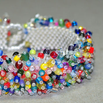 Arm Candy ... Caterpillar Bracelet . Colorful Jewelry . Fringed . Beadwoven . Bold . Multicolor . Festive . Rainbow . Brilliant . Lush