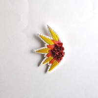 "Abstract embroidered brooch starburst design with bright yellow, pink and orange colors with red ""corral"" gems Spring,Summer fashion"