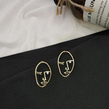 Face Handmade Metal Earrings