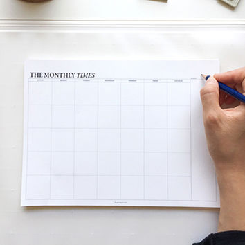 The Monthly times desk planner notepad with a zip lock pouch