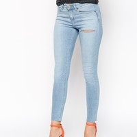 ASOS Lisbon Skinny Mid Rise Ankle Grazer Jeans in Phillipa Wash with Thigh Rip and Raw Hem