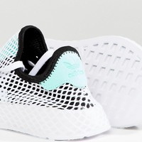 adidas Originals Deerupt Sneakers In Black And Green at asos.com