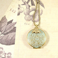 The beekeeper. locket necklace (turquoise patina)