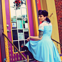blue 50s inspired pin up dress with lace and pockets