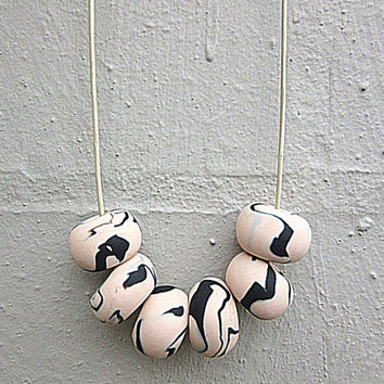 NL-132 Peach and Black Patchy Swirl Pattern Donut-shaped Polymer Clay Beads Handmade Necklace in Adjustable Champagne Colour Leather Cord