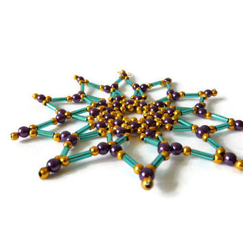 big seed bead star, tree ornament for Christmas decoration in turquoise, purple and gold