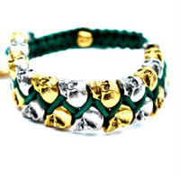 The Conflict Silver & Gold Skull Bracelet in Deep Green