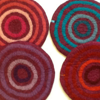 Handfelted Seat Cushion with coloured circles on red violet