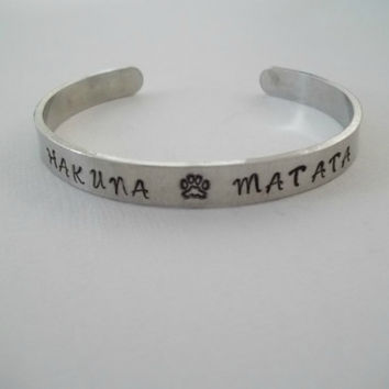 "Custom hand stamped aluminum bracelet cuff 1/4"" by 6"" Hakuna Matata with paw print Lion King"