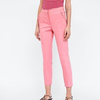 TROUSERS WITH FRILLED POCKETS DETAILS