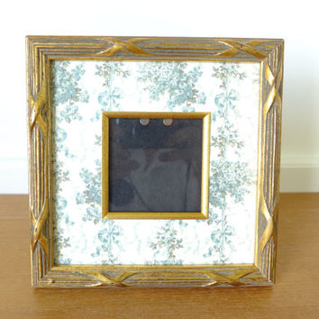 Square antique gold picture frame with floral and ribbon mat, possibly Anna Griffin