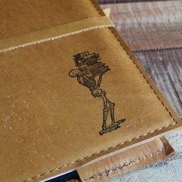 Skeleton Carrying Books Leather Journal