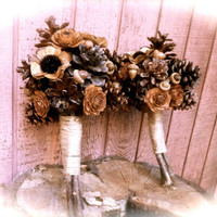Rustic wedding bridesmaids bouquet with pine cones for fall winter forest weddings