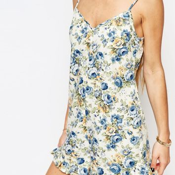 Reclaimed Vintage Frill Hem Playsuit With Low Back In Floral Print at asos.com