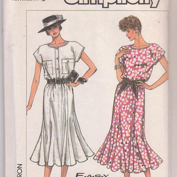 Vintage 1980s pattern for pullover, cap sleeved dress with flared, tulip skirt calf length misses size 6 8 10 12 Simplicity 8015 UNCUT