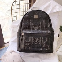 MCM Stark Backpack in Gunta M Studs Visetos