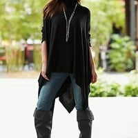 Black Sharkbite hem sweater, skinny jean, boot from VENUS