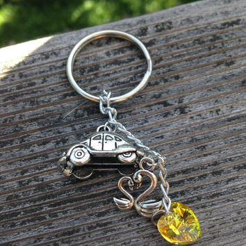 Emma Swan and Beetle Keychain - Once Upon a Time Character Keychain with Two Charms and Swarovski Crystal Heart