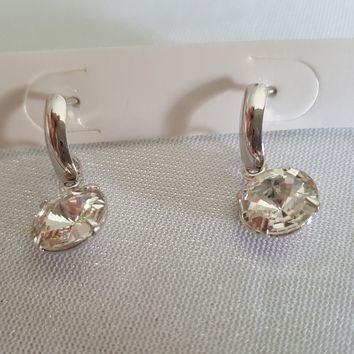Tiny little dangle on these super cute CZ crystal earrings.