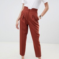 ASOS DESIGN tailored high waisted tapered pants with button detail at asos.com