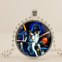 """Star Wars movie inspired movie poster 1"""" glass and metal Pendant necklace Jewelry."""