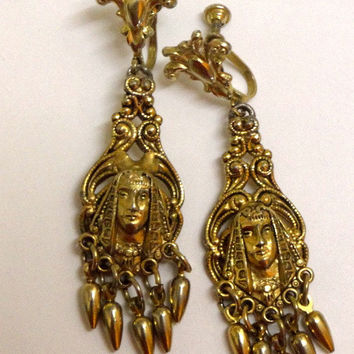 Vintage Egyptian Revival earrings. Pharaoh. Dangle fringe.  Gold brass. Screw backs. Stunning