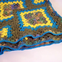 Granny square layered tiles in green, blue, yellow, and seagrass