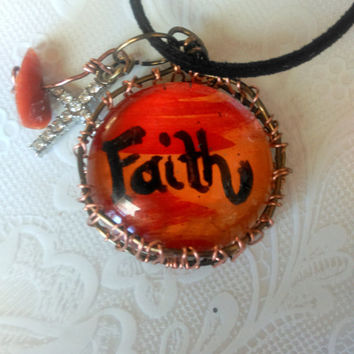 Orange Faith Hand Painted Glass Pendant in a Wire Woven Bezel Accented by a Rhinestone Cross & Red Aventurine Charms