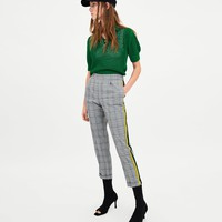 TROUSERS WITH SIDE BANDS DETAILS