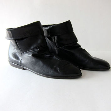 80s black leather ankle boots. low slung boots.